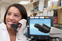 African female scientist using telephone