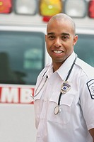 African male EMT next to ambulance