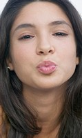 Hispanic girl blowing a kiss