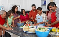 Multi-generational Hispanic family preparing food