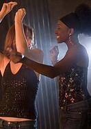 Two women dancing in nightclub