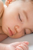 Close up of sleeping Hispanic baby