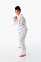Studio shot of Hispanic boy in martial arts stance