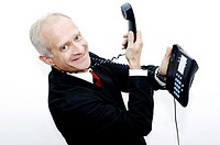 Businessman with a telephone hanging around his neck
