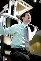 Businessman lifting weight in the gymnasium