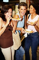 Hispanic women eating pizza