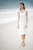 Woman taking a stroll along the beach