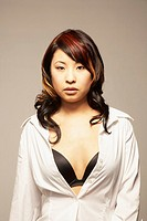 Asian woman with shirt unbuttoned