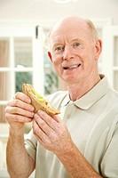 Senior man with a sandwich