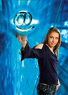 Woman picking on an internet symbol in a virtual world