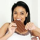 Lady enjoying a bar of chocolate