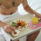 Man having breakfast in bed