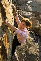 High angle view of woman rock climbing