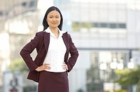 Asian businesswoman standing outdoors