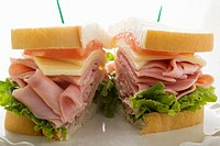 Ham, cheese and tomato sandwich halved