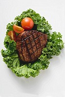 Grilled fillet steak on lettuce leaf