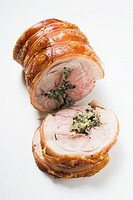 Rolled pork roast with herb stuffing and crackling