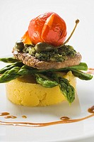 Veal escalope with herb crust on polenta and asparagus