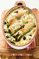 Cannelloni with spinach & sheep's cheese filling in dish