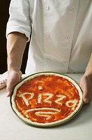 Pizza base spread with tomato sauce, with the word Pizza