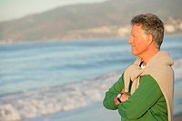 Mature man standing on the beach