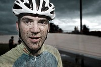 Athlete with dirty face wearing bike helmet