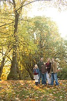 Family standing in park in autumn