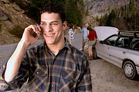Man with car trouble talking on cell phone