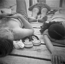 People relaxing on wooden deck