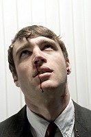 Businessman bleeding from the nose