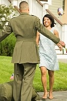 African wife greeting military soldier returning home
