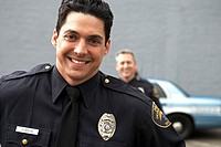 Male police officer smiling