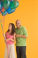 Young couple laughing with balloons