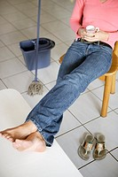 Woman relaxing after mopping