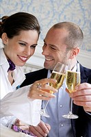 Couple toasting each other with champagne (thumbnail)