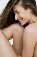 Close up of young nude woman smiling