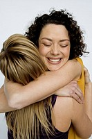 Young women hugging (thumbnail)