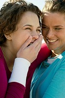 Two women laughing and joking (thumbnail)