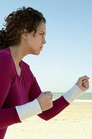 Woman practicing self-defense at beach