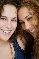 Close-up of two women smiling