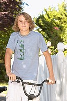 Young boy posing with his bicycle