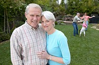 Senior couple hugging in backyard