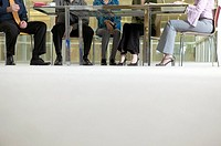 Businesspeople´s feet under a table