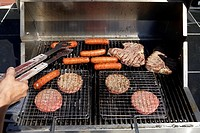 Hotdogs and hamburgers on grill
