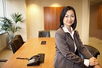 Asian businesswoman in conference room
