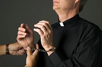 Priest being handcuffed