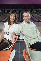 Couple smiling in bowling alley