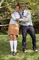 Teenage couple hugging outdoors