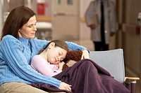 Mother with sleeping daughter in waiting room