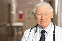 Mature adult male doctor smiling